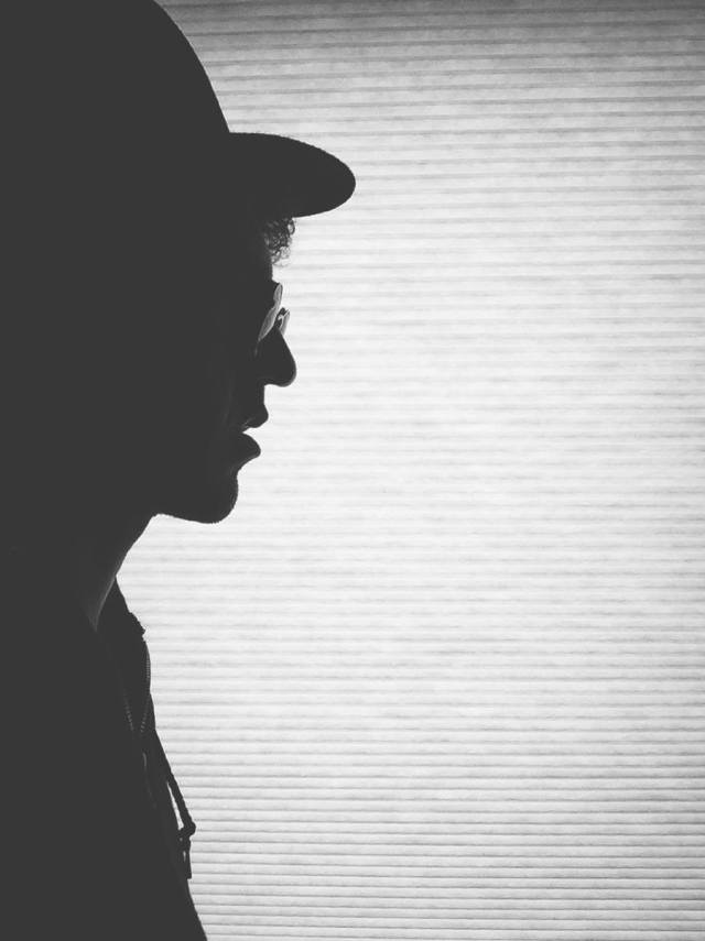 Silhouette Profile of a young hipster boy.