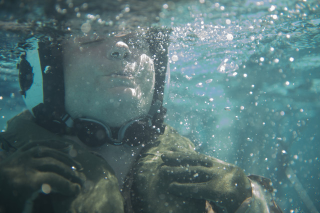 A military pilot in water survival training.