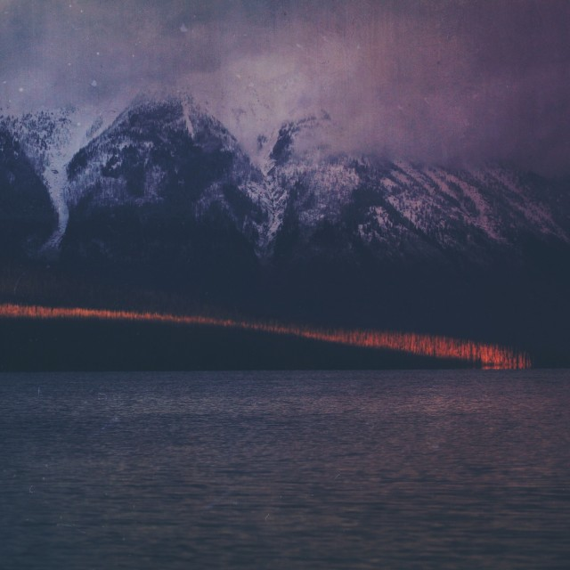 Beam of light hits McDonald Lake in Glacier Park, Montana