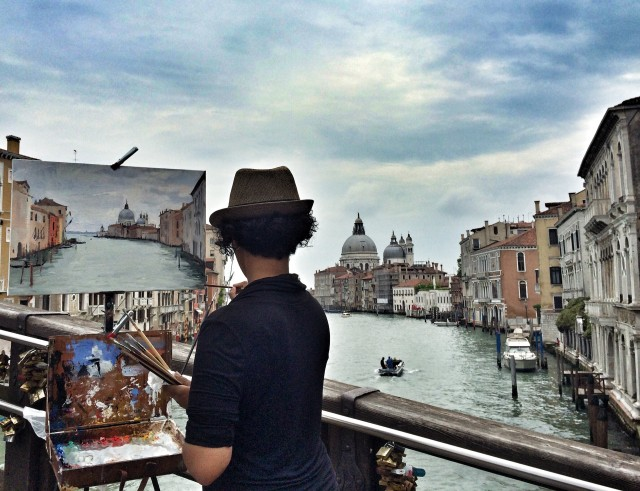 The artist is drawing Venice.