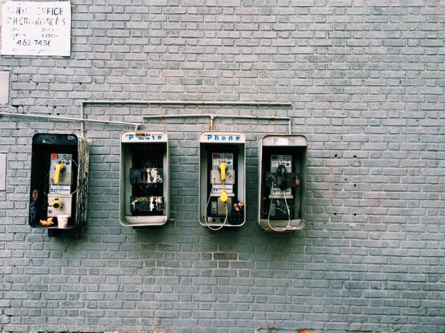 Four broken pay phones, broken system, bright colors, color pop, phones, old technology, analog system