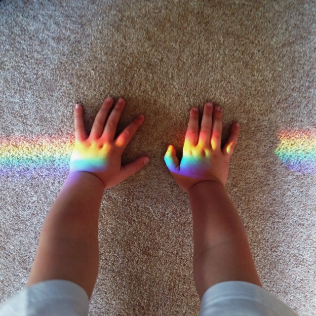 Child catching rainbow