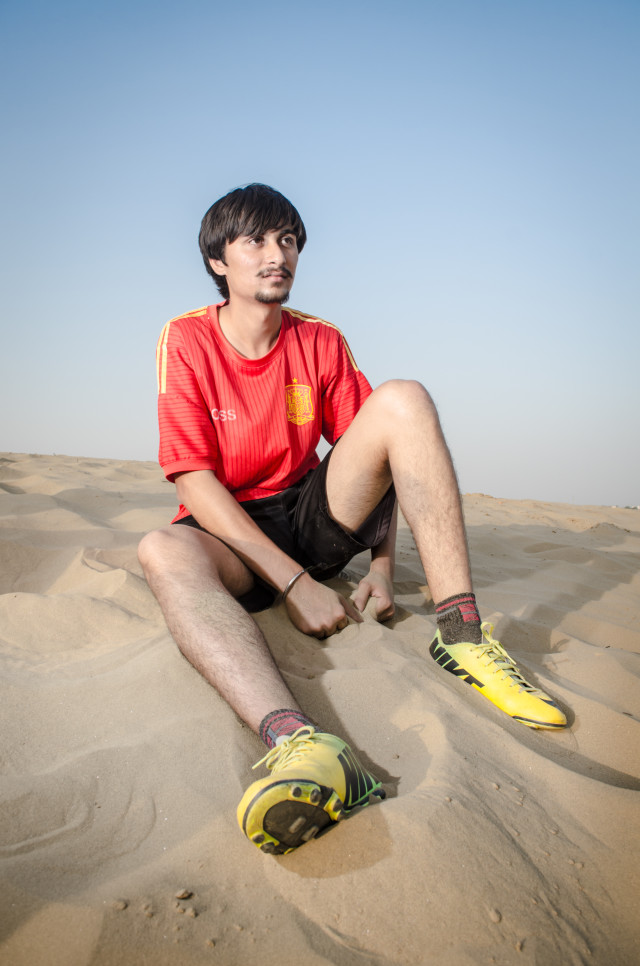 Football Player in Desert