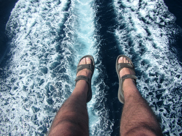 Flying feet over water trail, doing parasailing