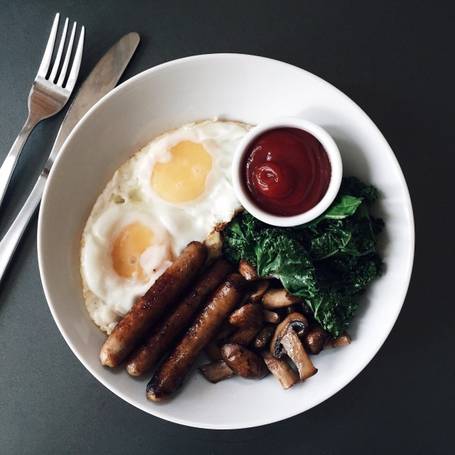 Breakfast with eggs, maple sausage, crimini, and kale.