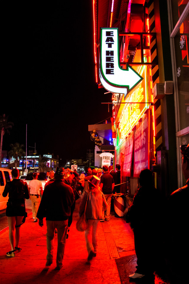 People walking by the nightclubs and restaurants area of Los Cabos Downtown in Mexico. December 31st, 2014.