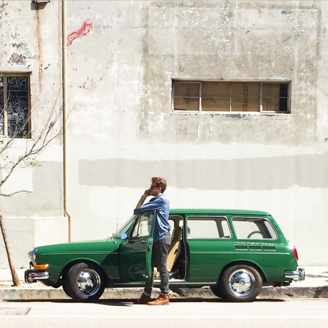 Man and his green car