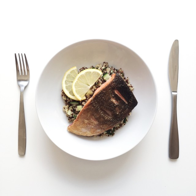 Crispy pan-seared salmon with warm bulgur and quinoa salad