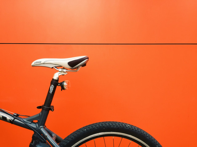 My bike in front of orange background