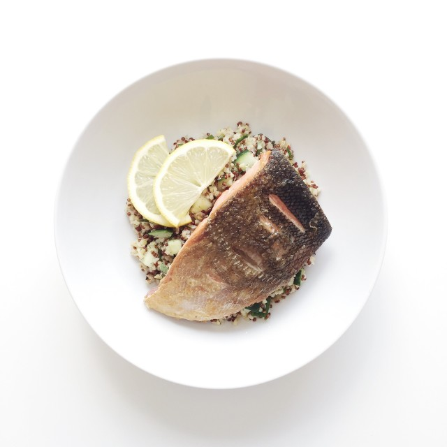 Top view of plate of pan-seared salmon with warm bulgur and quinoa salad