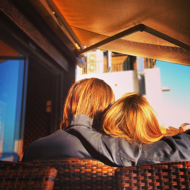 Golden couple. Guy and girl with red hair sitting in a cafe in a embrace