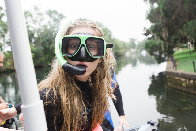 Girl ready to snorkel with manatees