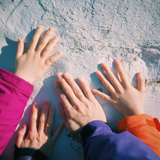 Family hands on a monument