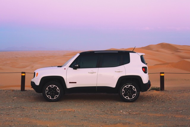Jeep Renegade 2015 and a pinks sunset in the desert