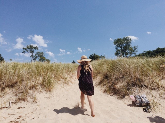 Girl at dunes beside Lake Michigan.