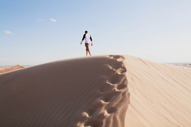 Man traversing the dunes