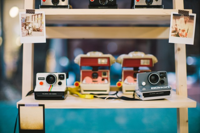Polaroid cameras on shelf