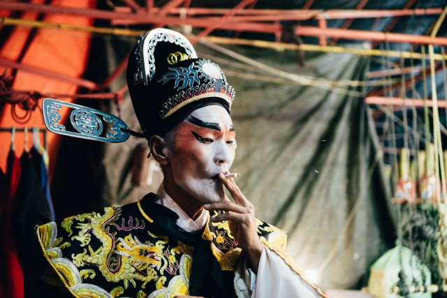 Chinese opera man taking a break