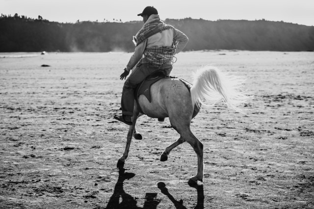 Man on a horse at Bromo mountain indonesia