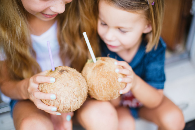 Children with coconuts.