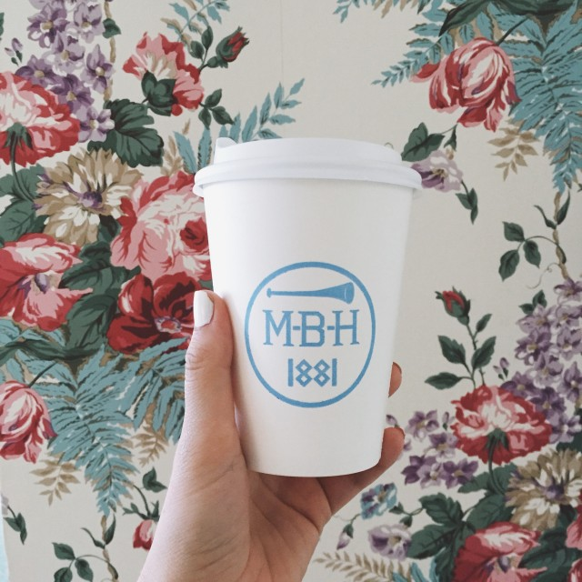 White coffee cup on a floral background