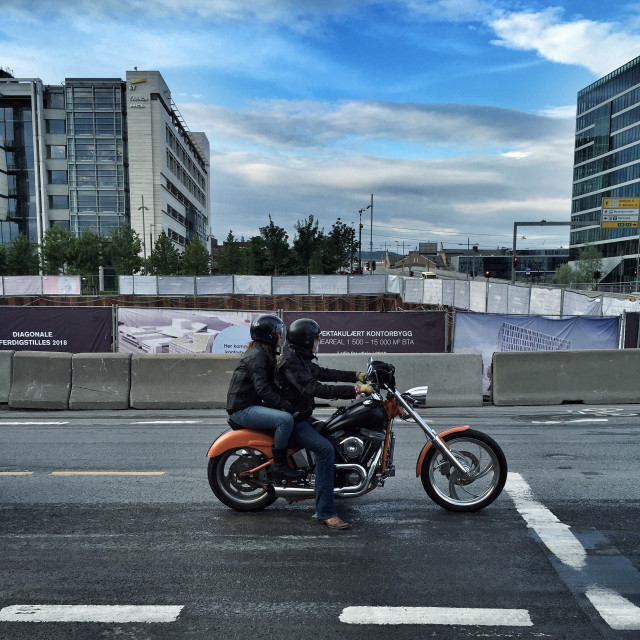 Couple of bikers in a urban environment