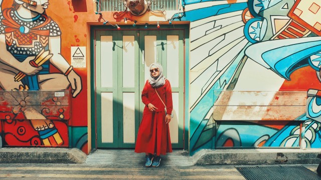 hijab with red dress and awesome mural