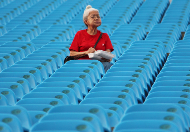 Lady in the stadium, Singapore
