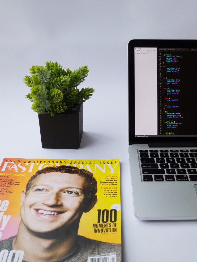 Tech magazine inspiration for entrepreneur coding on Mac book.