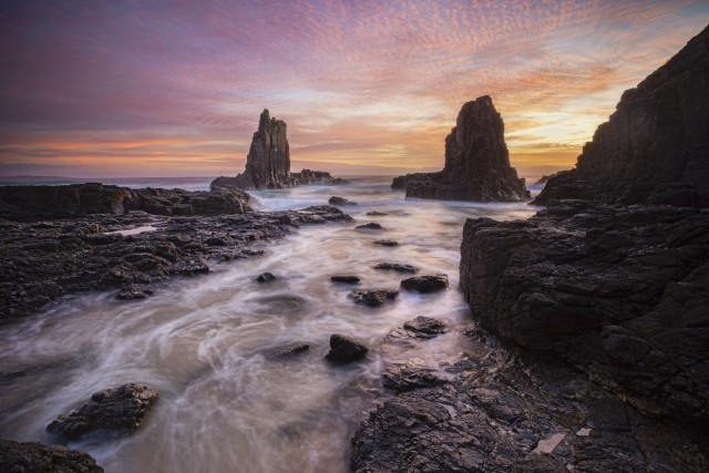 The morning sky celebrating sunrise at Cathedral Rocks, Kiama, NSW, Australia.