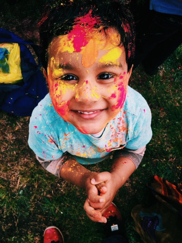 Happy Kid enjoying festival of colors