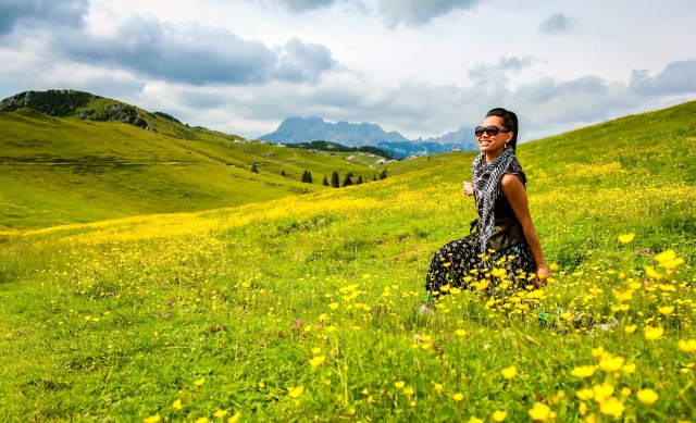 Attractive Asian woman enjoying in spring field on mountain