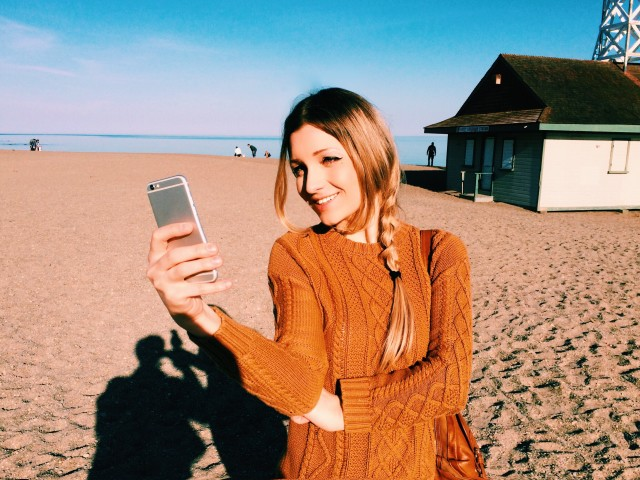 Smiling girl and phone