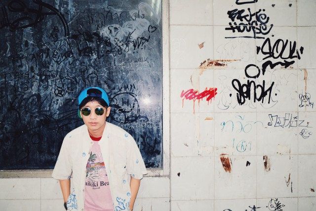 Street fashion boy in abandoned building