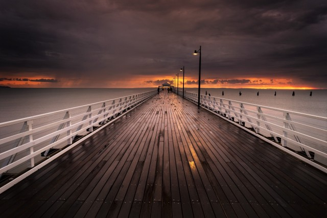 Golden Storm - a golden sunrise storm at the end of the newly refurbished Shorncliffe Pier