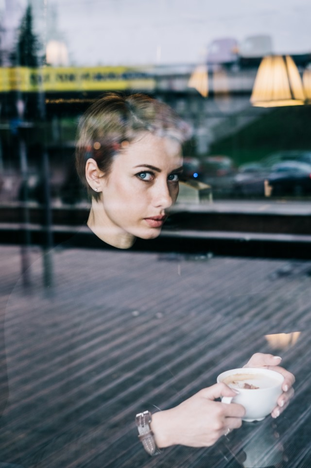 Woman drinking coffee in the restaurant