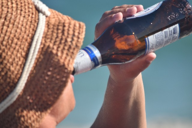 Cold beer in hot sun