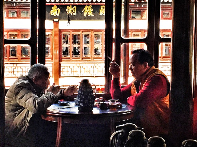 Old men drinking tea in old tea house in Shanghai