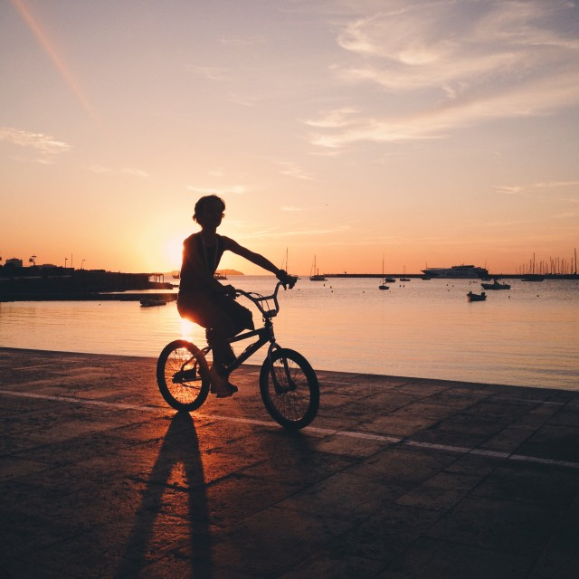 Biking child during sunset