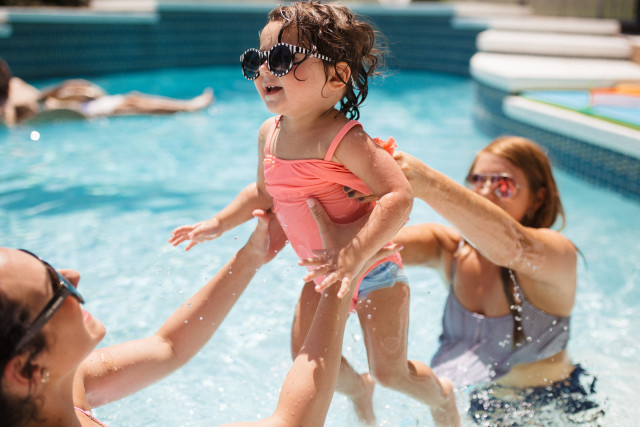 Happy toddler playing in pool.