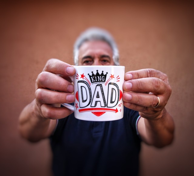 King dad holding a mug