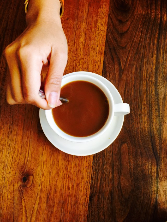 Hand in frame. Coffee