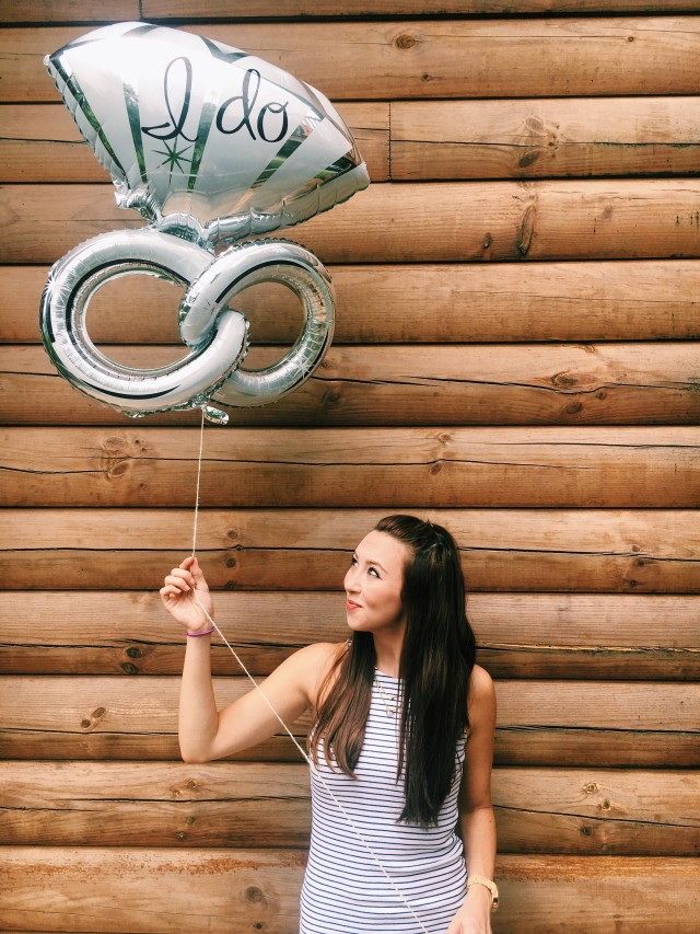 Bachelorette holding a wedding balloon