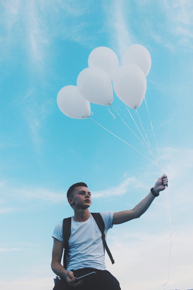 A boy with balloons ☄