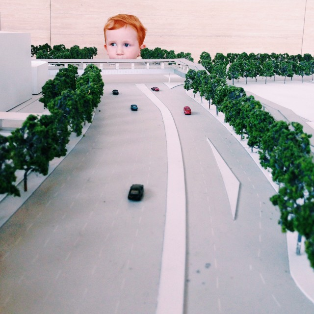 Child looking at a small scale city model