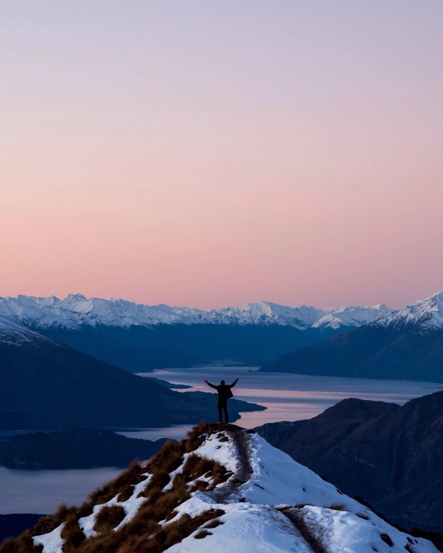 Watching the sunset from Mt Roy in New Zealand.