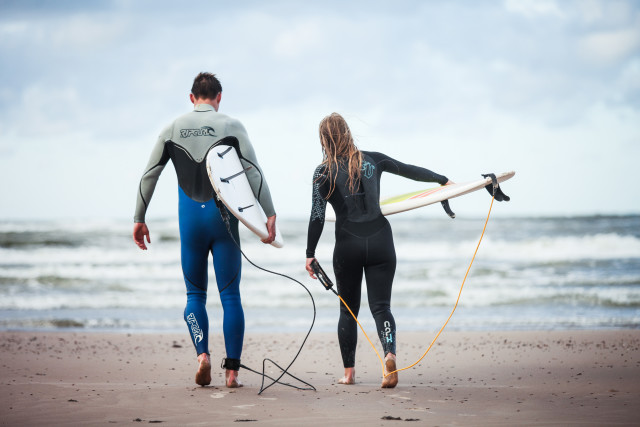 Surfing couple
