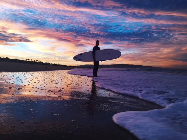 Sunrise surfing session at Manhattan Beach, CA