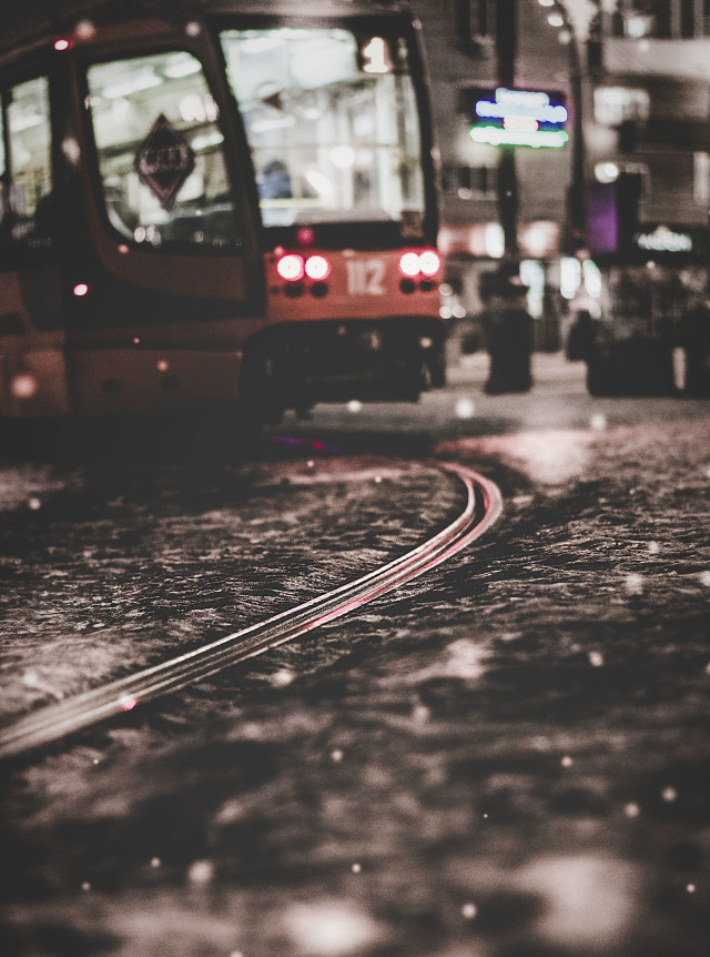 Moody tram in the night city.