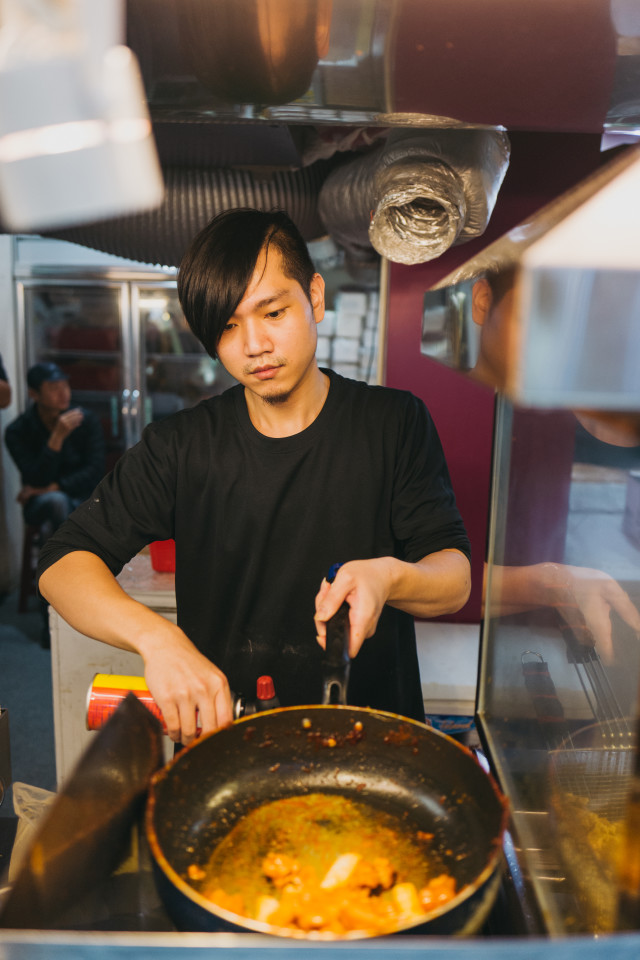 Local chef making hot pan food